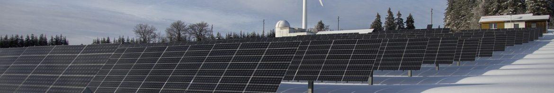 solar and wind energy on snowy field